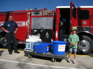 C loading up the pennies in the fire truck!